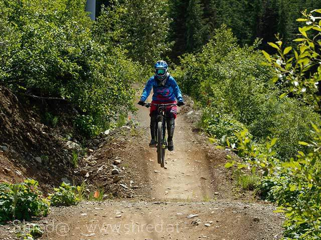 mountain biking a-line at whistler bike park