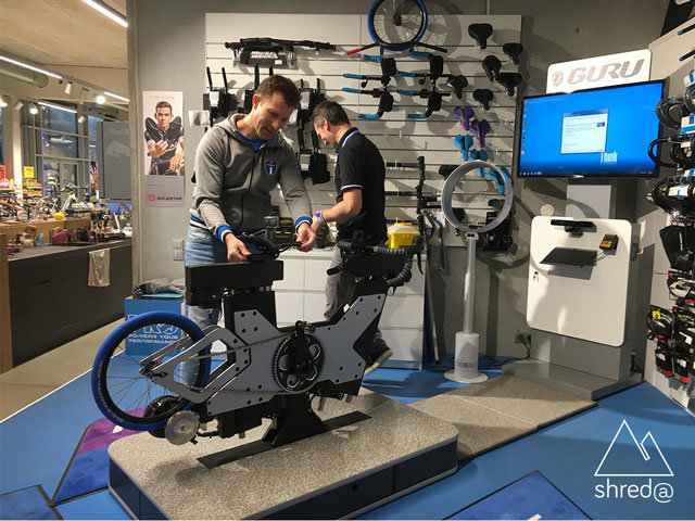 two men adjusting test bike for the bike-fitting session
