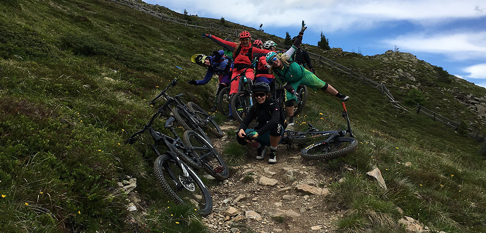 group of female mountain bikers having fun on a trail
