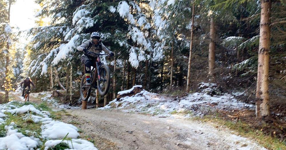 female mountain biker jumping
